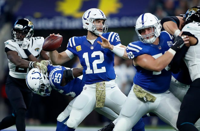 Indianapolis Colts quarterback Andrew Luck (12) drops back to pass on the Jacksonville Jaguars defense in the first half of their game at Lucas Oil Stadium on Sunday, Nov. 11, 2018.