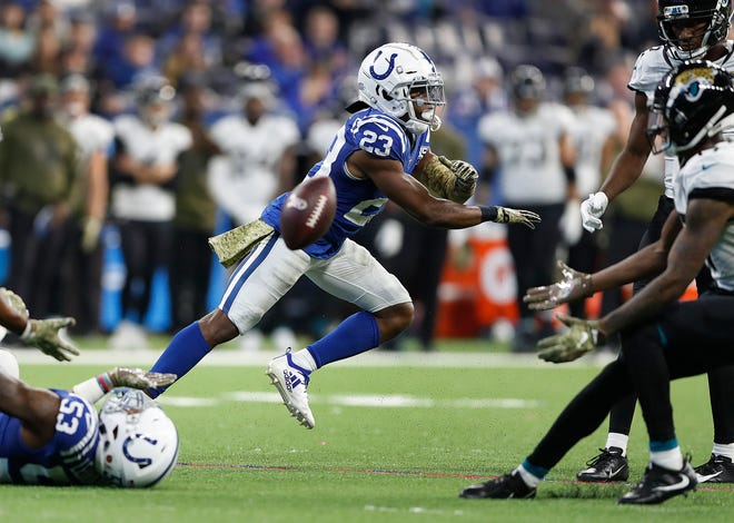 Indianapolis Colts cornerback Kenny Moore (23) reacts to breaking up a Jacksonville Jaguars pass attempt in the second half of their game at Lucas Oil Stadium on Sunday, Nov. 11, 2018. The Colts defeated the Jaguars 29-26.
