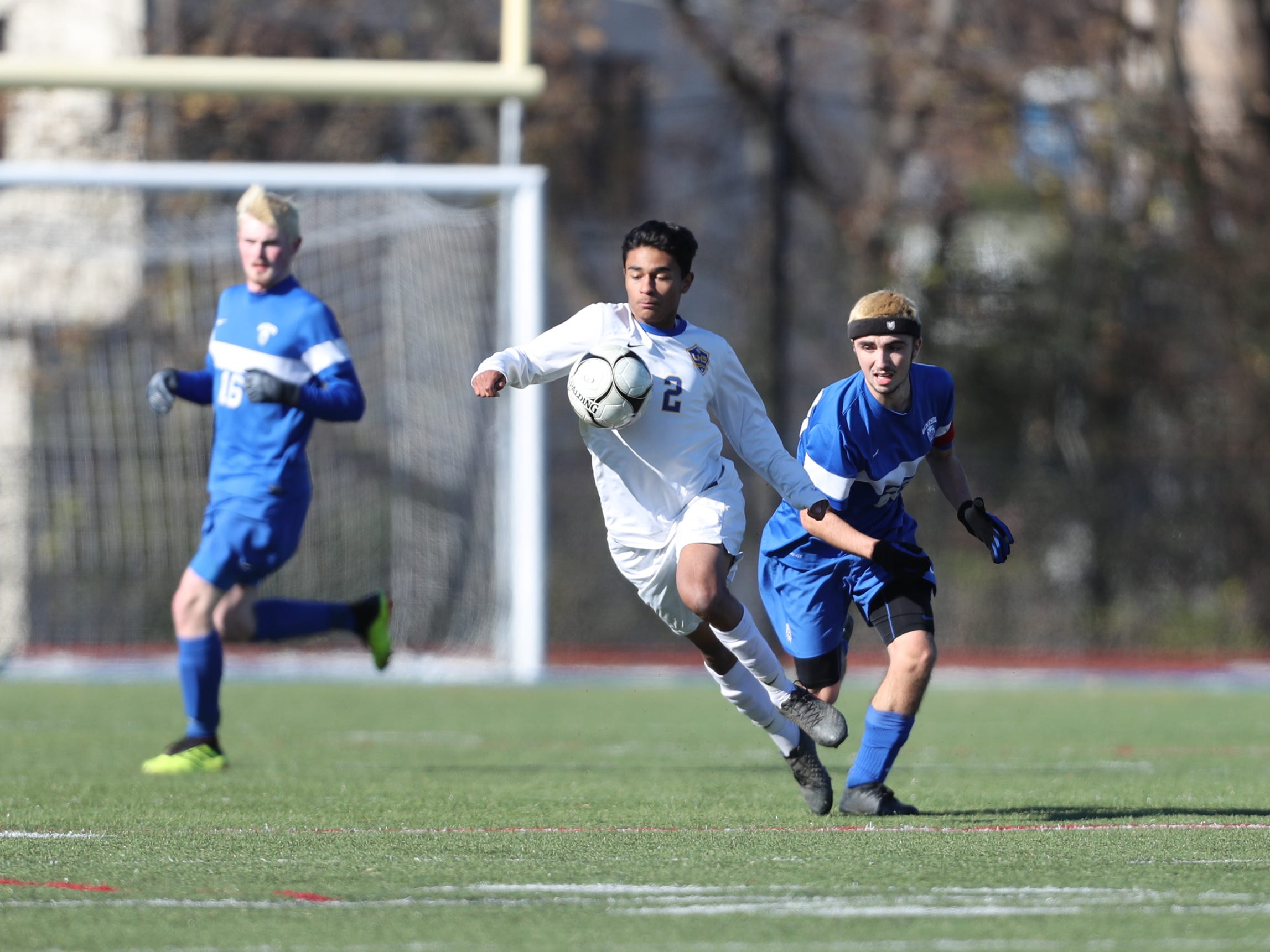Lansing's Langston Hopkins (2) works the ball near midfield during their 3-0 win over Geneseo in the Class C boys state soccer final at Middletown High School in Middletown on Sunday, November 11, 2018.