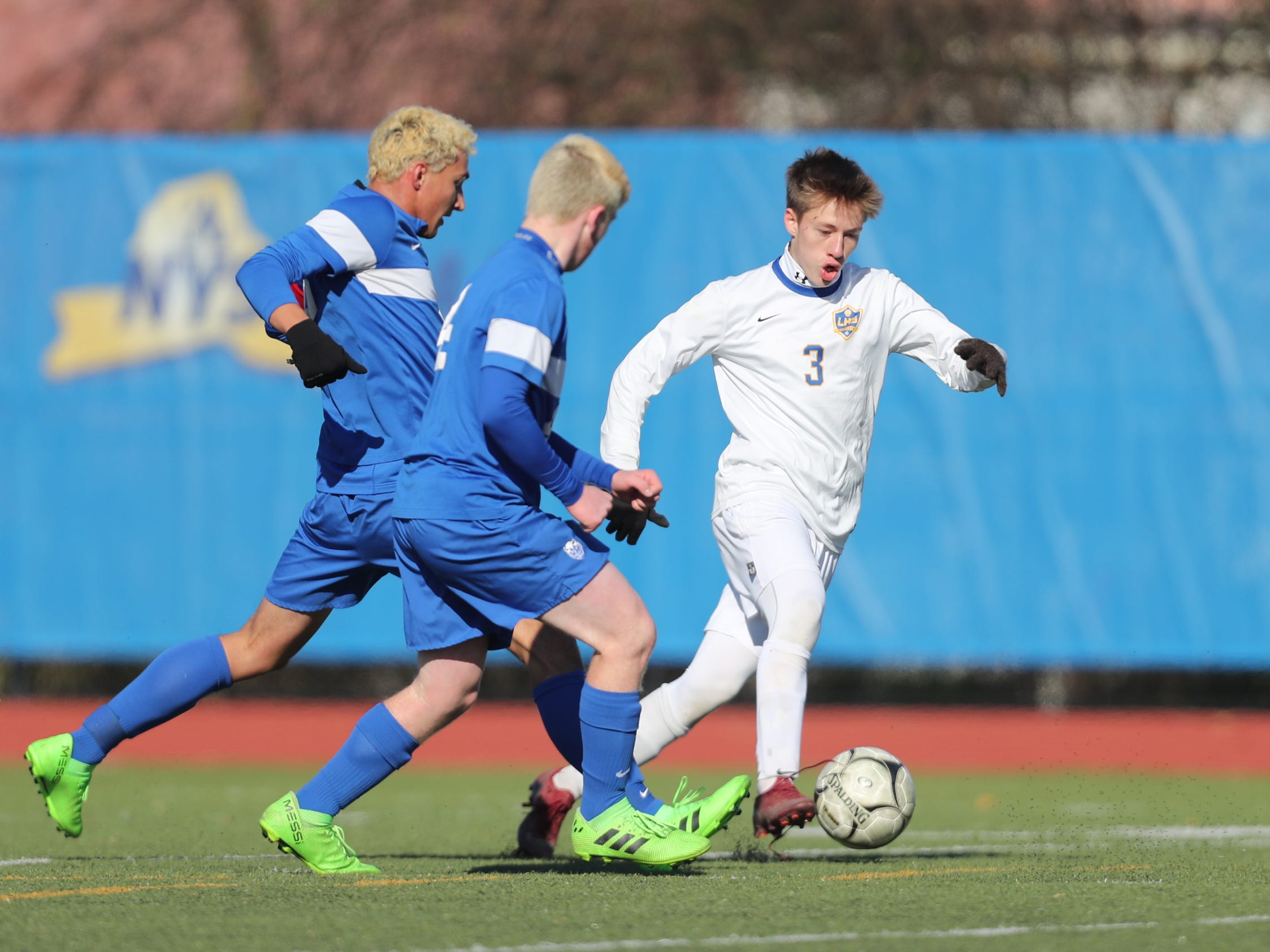 Lansing's Eric Goehler (3) works the ball through the Geneseo defense during Lansing's 3-0 win over Geneseo in the Class C boys state soccer final at Middletown High School in Middletown on Sunday, November 11, 2018.