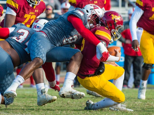 East Mississippi defensive lineman LaShawn Paulino-Bell (8) sacks Jones quarterback Stetson Bennett (5) during MACJC Championship Game action held Saturday November 10th, 2018 in Ellisville, Mississippi.(Photo/Bob Smith-For the Clarion Ledger)