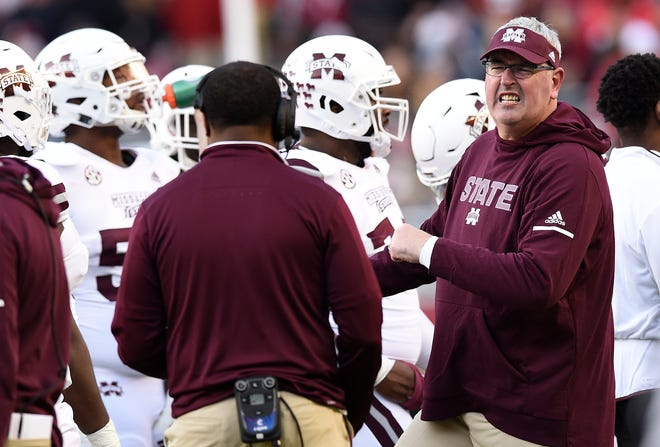 Mississippi State Bulldogs head coach Joe Moorhead yells to officials after series of downs against the Alabama Crimson Tide during the second quarter at Bryant-Denny Stadium.