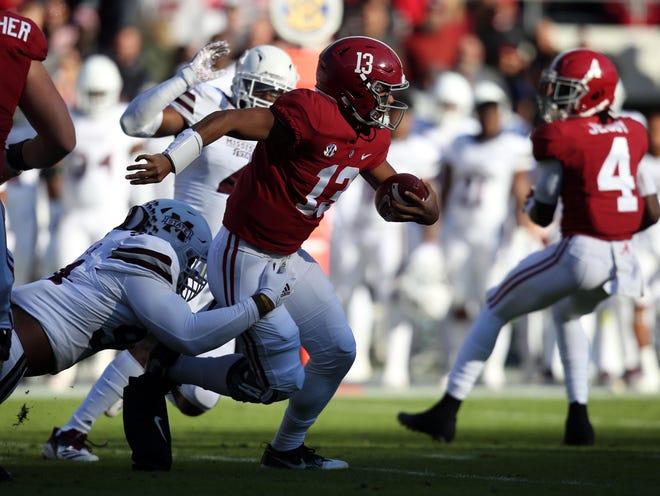 Alabama sophomore quarterback Tua Tagovailoa gets pressured by the Mississippi State defense. Tagovailoa was sacked a season-high four times in the Crimson Tide's 24-0 victory.