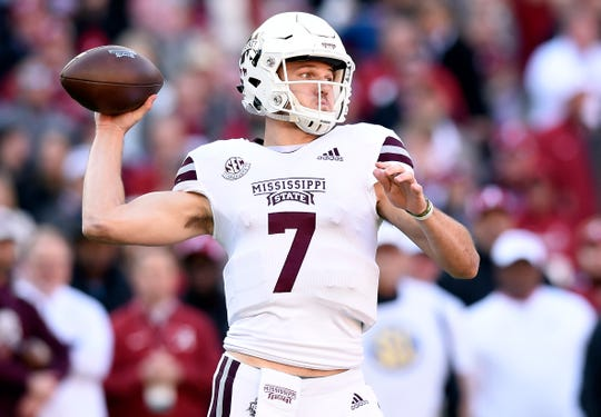 Mississippi State Bulldogs quarterback Nick Fitzgerald (7) drops back to pass against the Alabama Crimson Tide during the first quarter at Bryant-Denny Stadium.