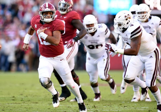 Alabama Crimson Tide quarterback Tua Tagovailoa (13) scrambles up the field for yardage against the Mississippi State Bulldogs during the first quarter at Bryant-Denny Stadium.