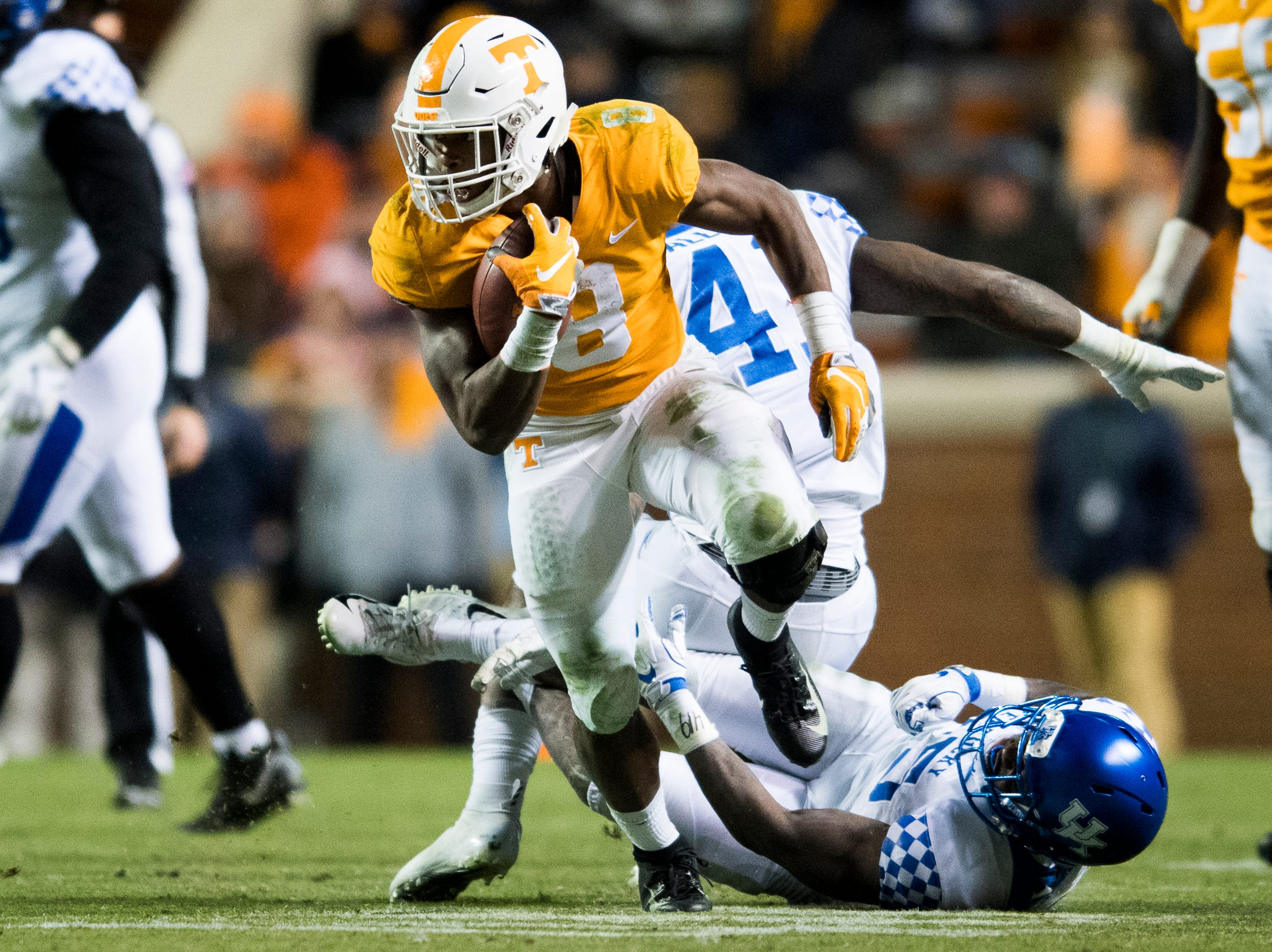 Tennessee running back Ty Chandler (8) runs past the Kentucky defense during a game between Tennessee and Kentucky at Neyland Stadium in Knoxville, Tennessee on Saturday, November 10, 2018.