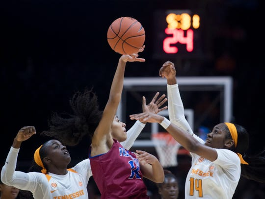 Tennessee's Zaay Green (14) steals the ball from Presbyterian's Tess Santos (15).