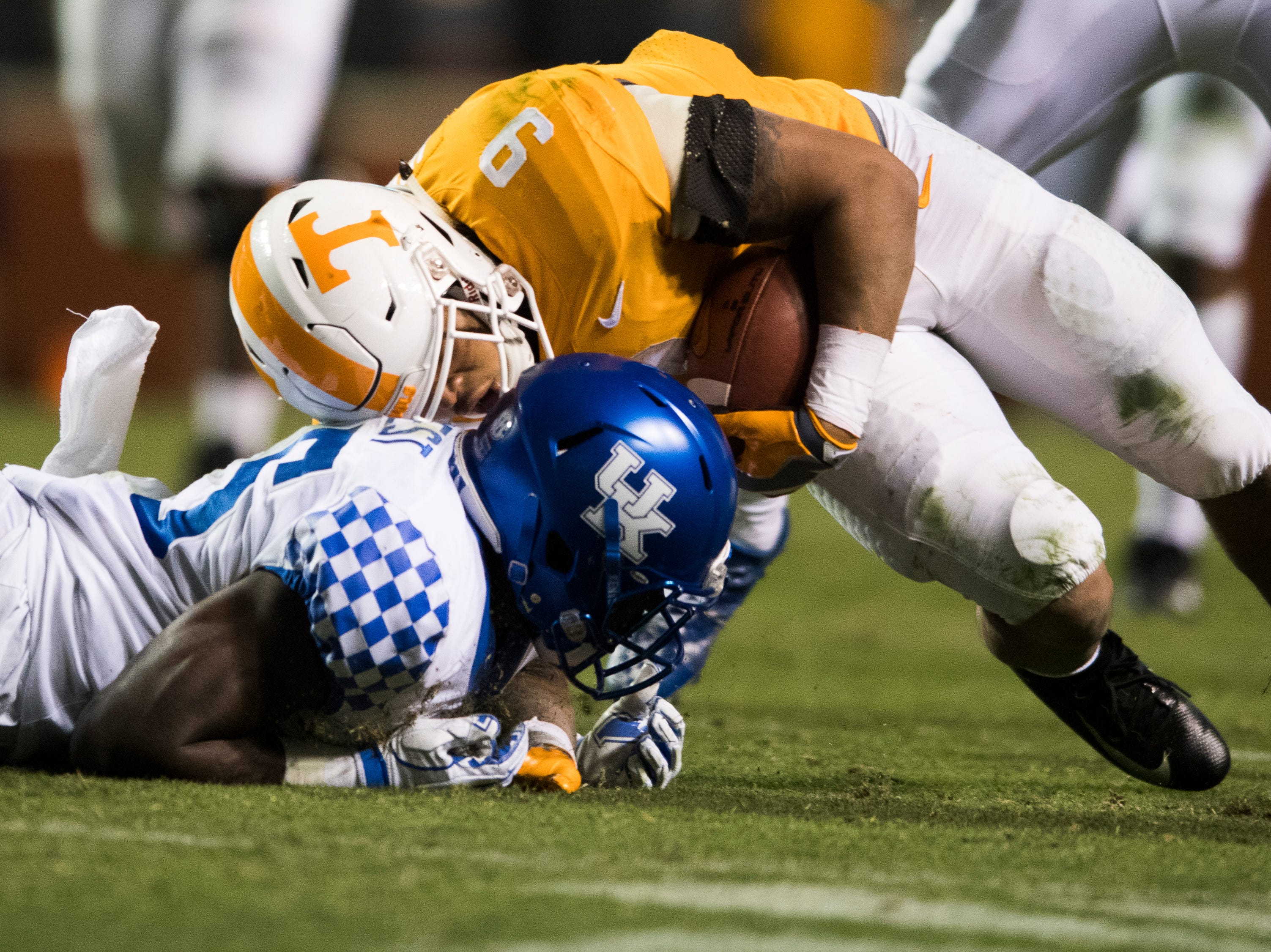 Tennessee running back Tim Jordan (9) keeps running as Kentucky safety Darius West (25) tries to tackle him to the ground  during a game between Tennessee and Kentucky at Neyland Stadium in Knoxville, Tennessee on Saturday, November 10, 2018.