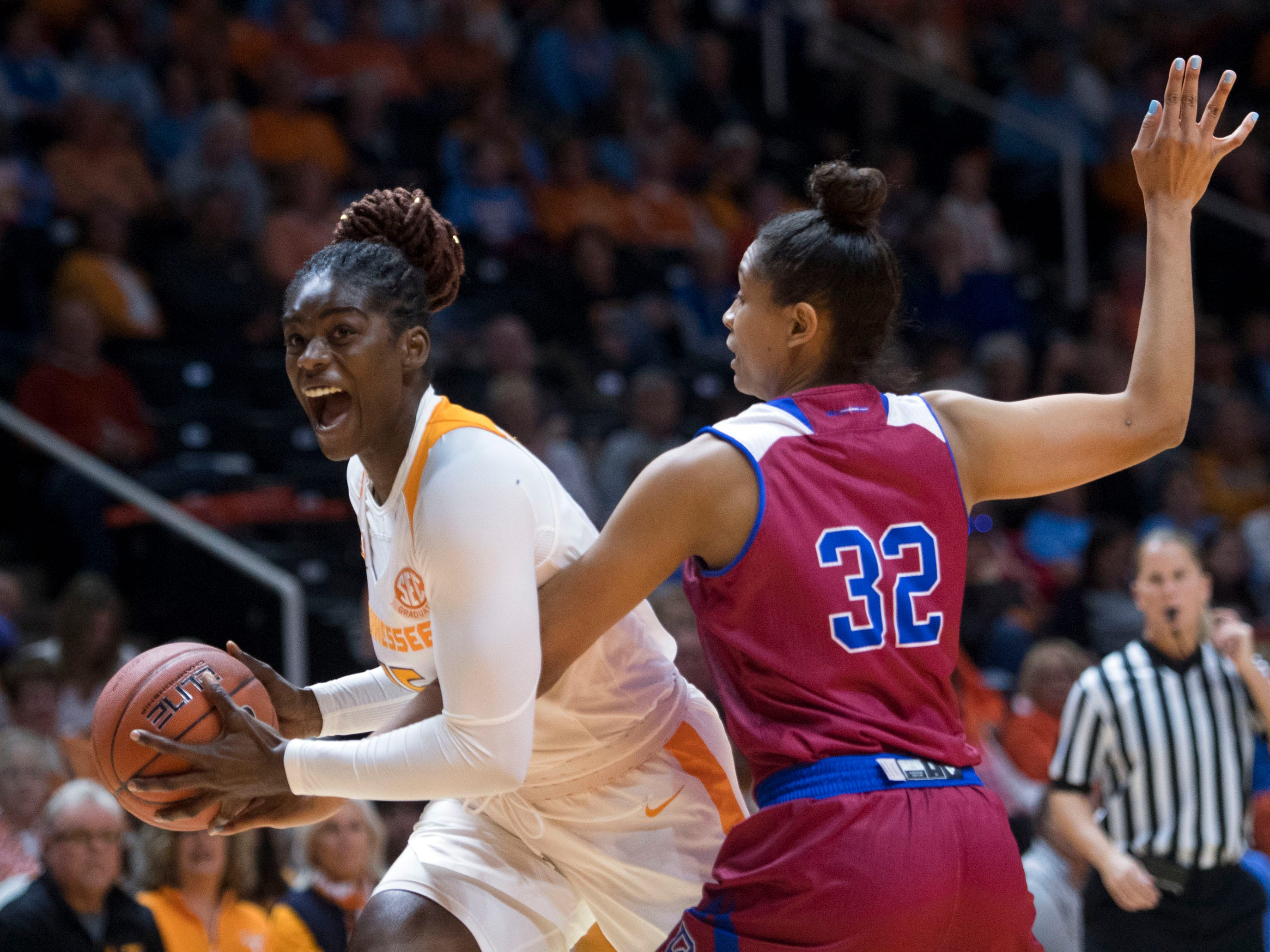 Tennessee's Cheridene Green (15) looks towards the basket while defended by Presbyterian's Kiara Jackson (22)  on Sunday, November 11, 2018.