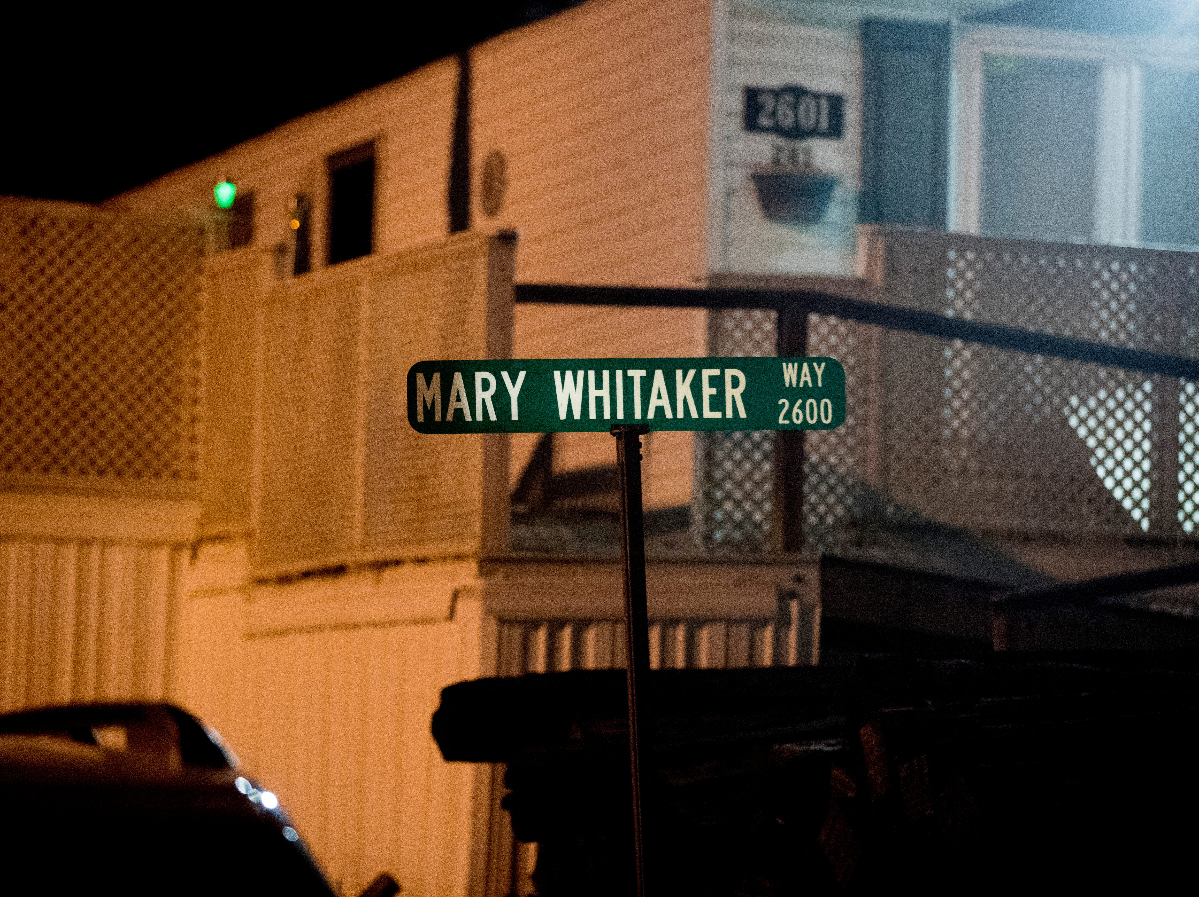 Mary Whitaker Way sign is lit up at the scene of a shooting on Forest Edge Way in Knoxville, Tennessee on Saturday, November 10, 2018. One victim was confirmed dead at the scene and a second injured.