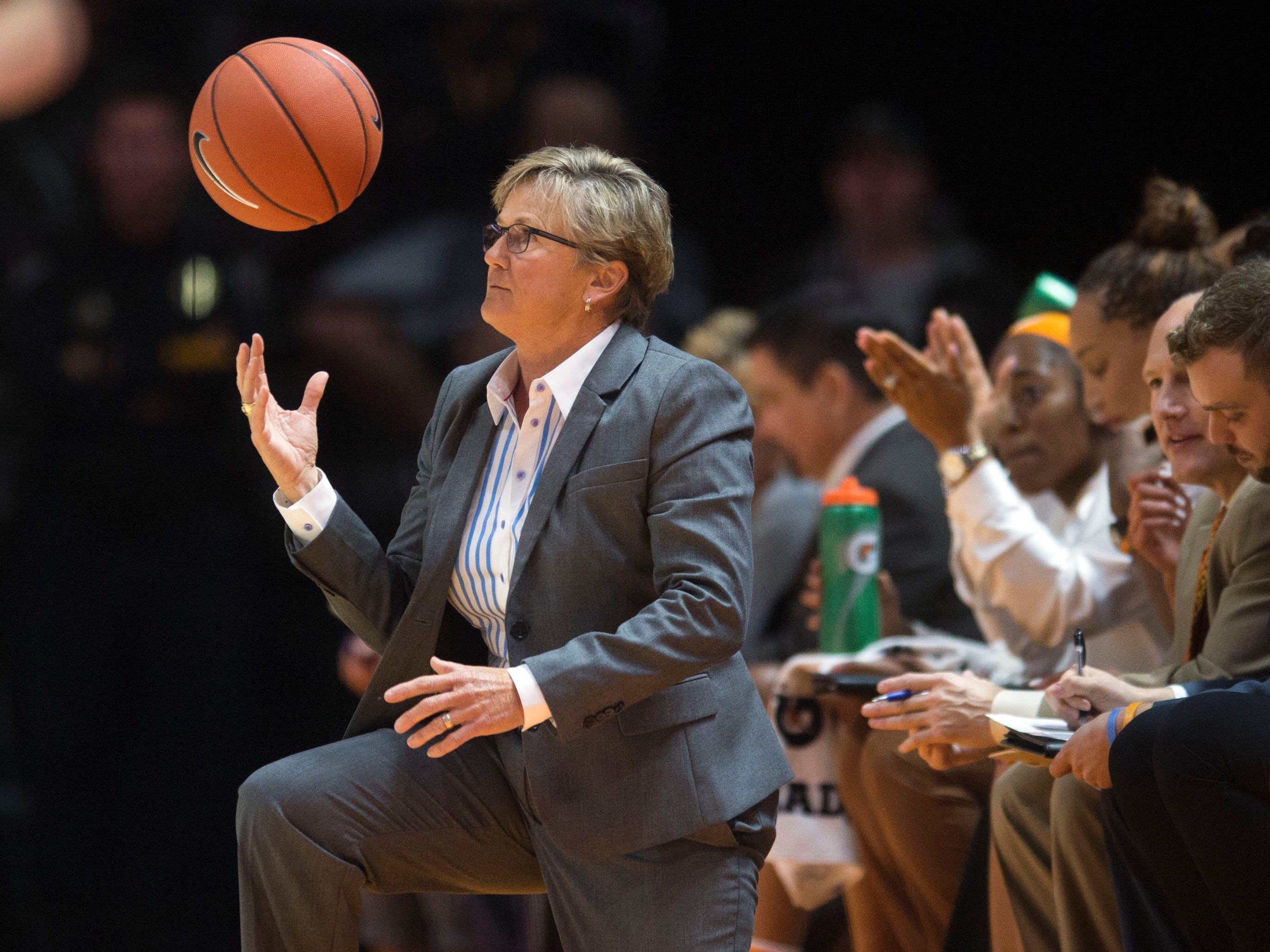 Tennessee head coach Holly Warlick gets the ball that rolled out of bounds during the  Lady Vols home opening game the Presbyterian Blue Hose on Sunday, November 11, 2018.