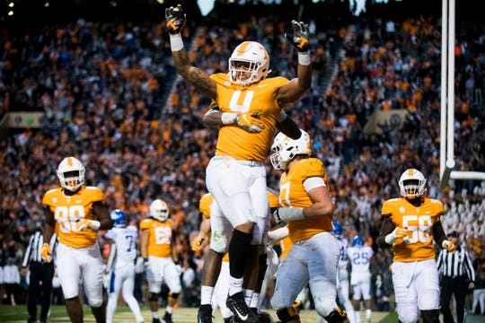 Tennessee tight end Dominick Wood-Anderson (4) celebrates after making a touchdown during a game against Kentucky at Neyland Stadium in Knoxville on Saturday, Nov. 10, 2018.