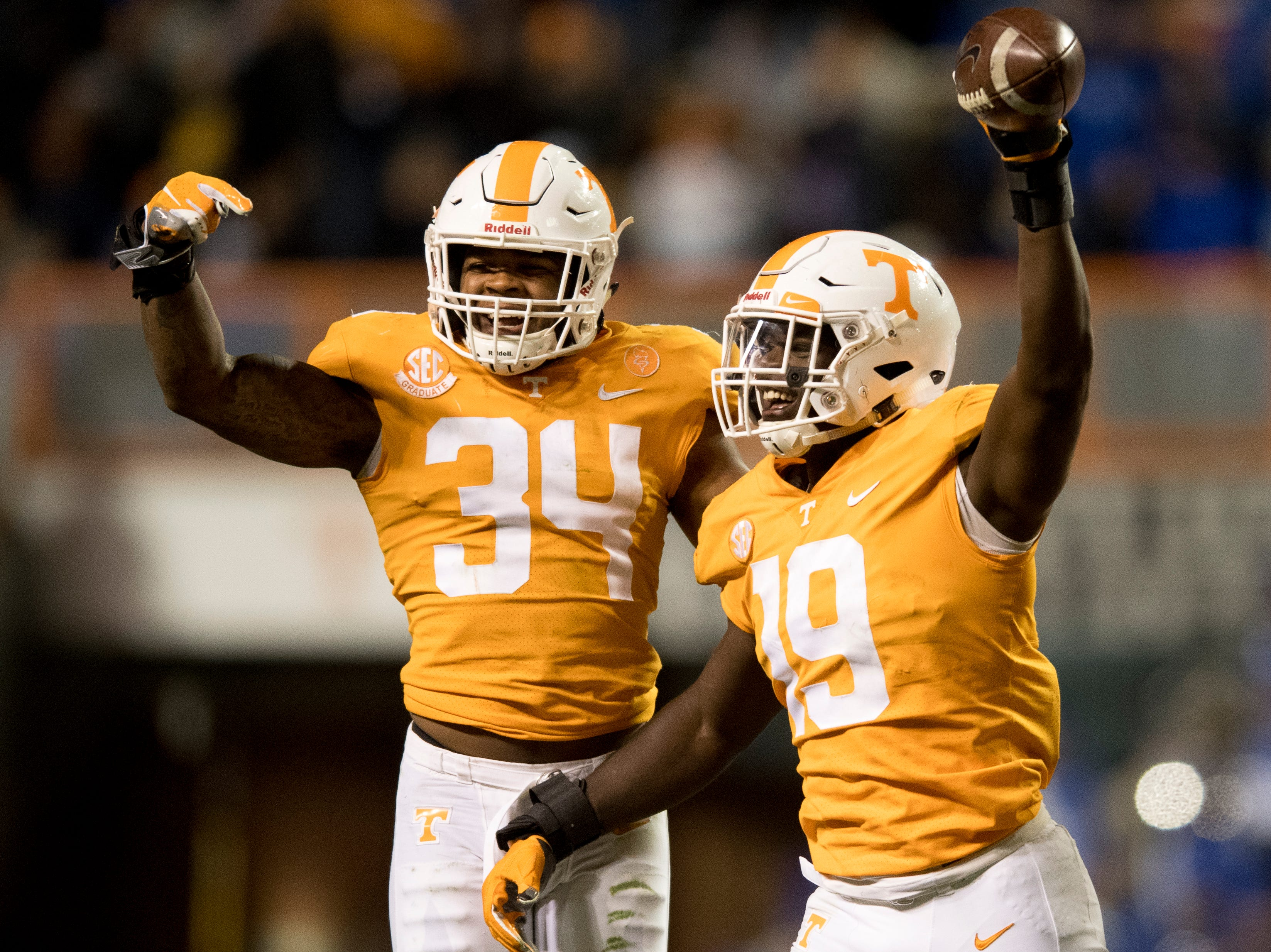 Tennessee linebacker Darrell Taylor (19) celebrates with Tennessee linebacker Darrin Kirkland Jr. (34) after making an interception during a game between Tennessee and Kentucky at Neyland Stadium in Knoxville, Tennessee on Saturday, November 10, 2018.