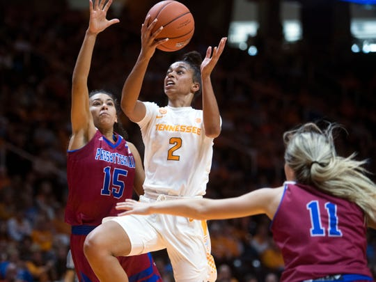 Tennessee's Evina Westbrook (2) takes a shot at the basket while defended by Presbyterian's Tess Santos (15) and Kacie Hall (11) on Sunday, November 11, 2018.