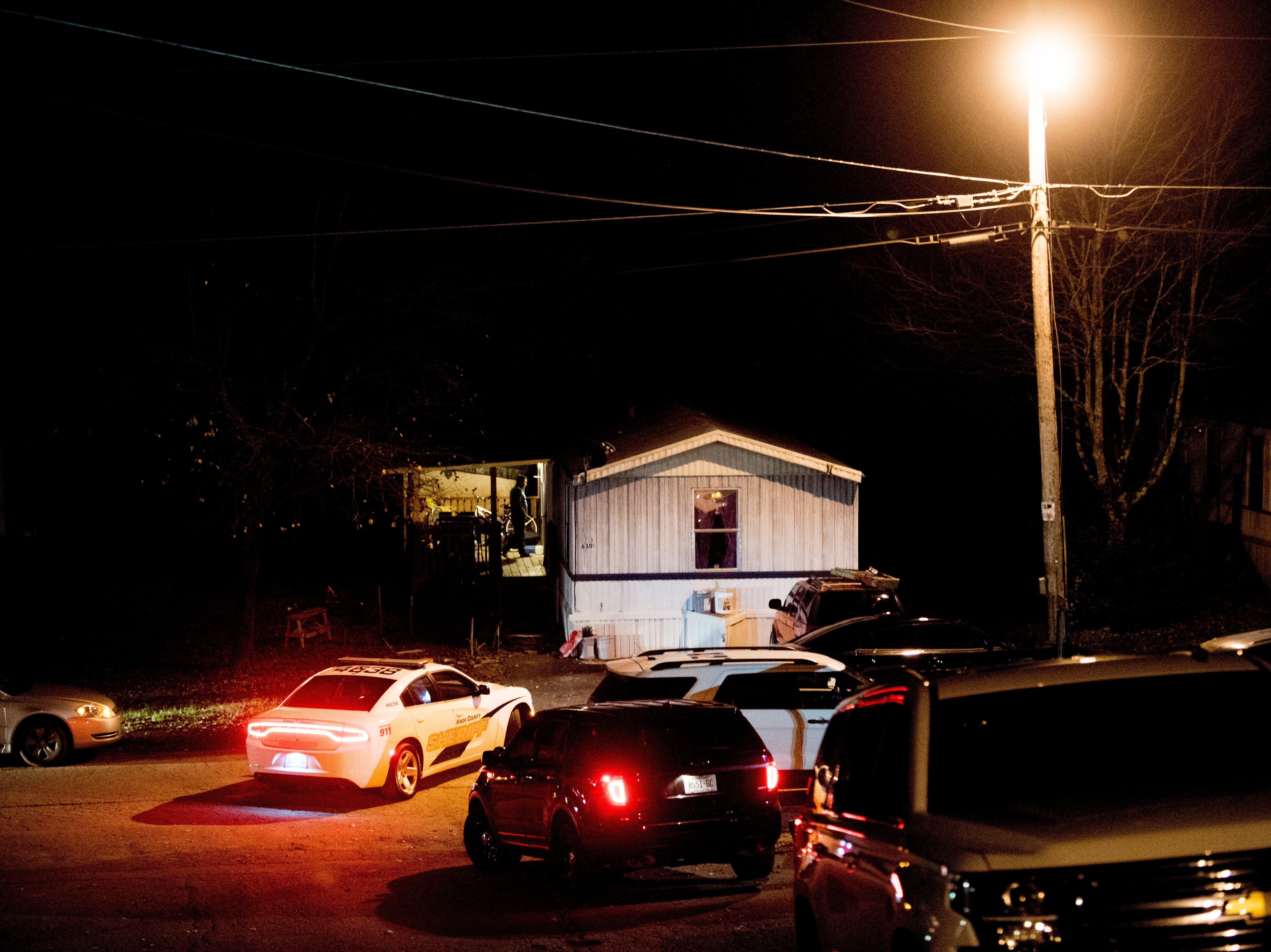 Knox County Sheriff's vehicles at the scene of a shooting on Forest Edge Way in Knoxville, Tennessee on Saturday, November 10, 2018. One victim was confirmed dead at the scene and a second injured.