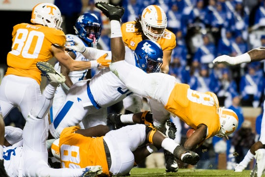 Tennessee running back Ty Chandler (8) leaps for extra yardage during a game between Tennessee and Kentucky at Neyland Stadium in Knoxville, Tennessee on Saturday, November 10, 2018.