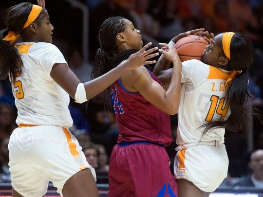 Tennessee's Zaay Green (14) steals the ball from Presbyterian's Ericka Blackwell-Boyden (44) on Sunday.