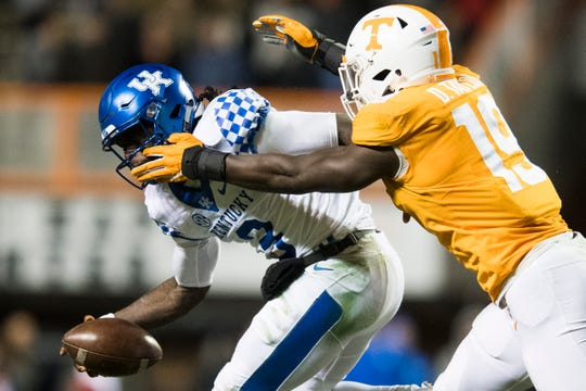 Kentucky quarterback Terry Wilson (3) is sacked by Tennessee linebacker Darrell Taylor (19) during a game between Tennessee and Kentucky at Neyland Stadium in Knoxville, Tennessee on Saturday, November 10, 2018.