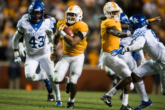 Tennessee running back Tim Jordan (9) runs past Kentucky linebacker DeAndre Square (43) as Tennessee wide receiver Marquez Callaway (1) defends during a game between Tennessee and Kentucky at Neyland Stadium in Knoxville, Tennessee on Saturday, November 10, 2018.