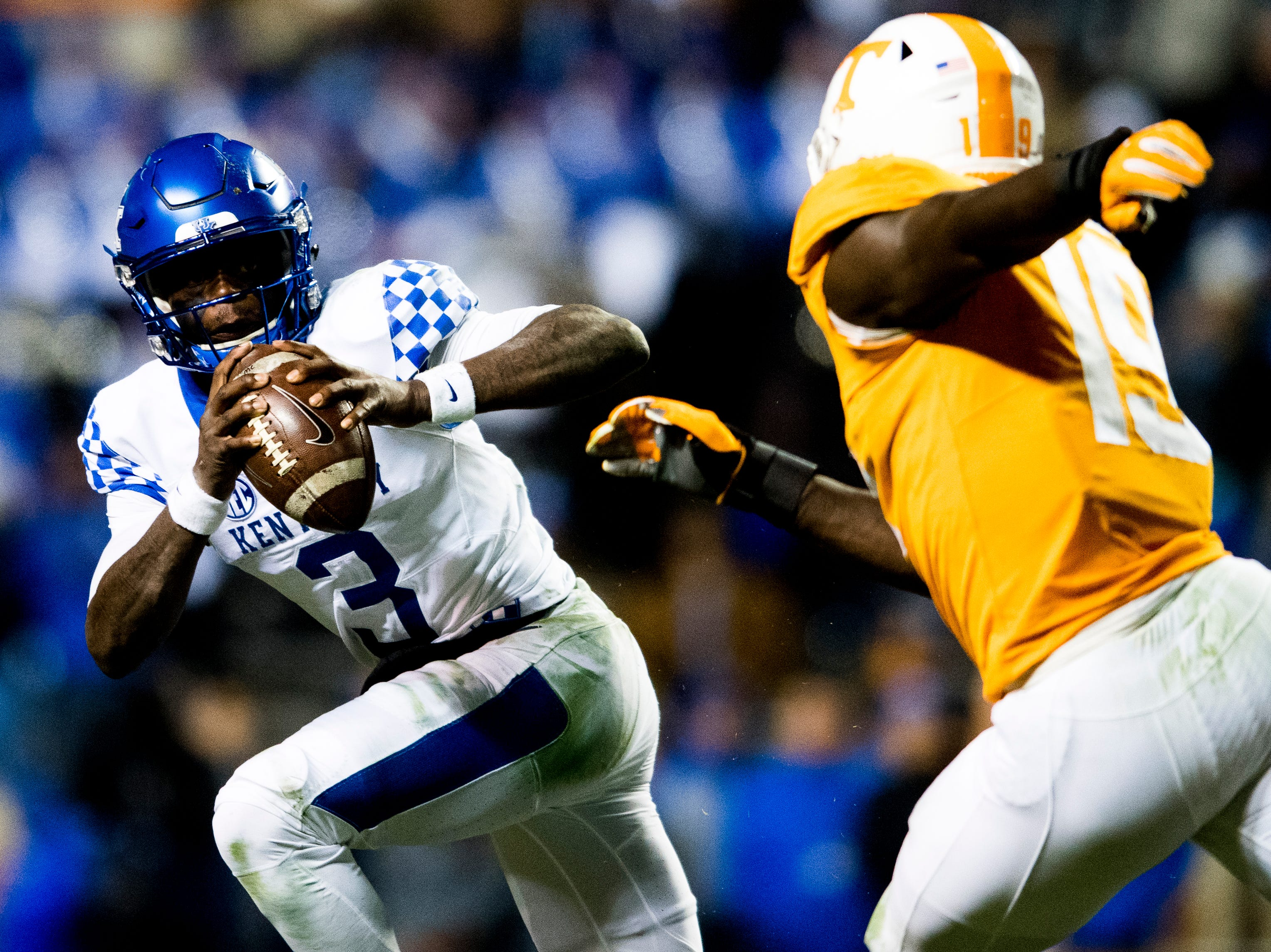 Kentucky quarterback Terry Wilson (3) looks to pass as Tennessee linebacker Darrell Taylor (19) defends during a game between Tennessee and Kentucky at Neyland Stadium in Knoxville, Tennessee on Saturday, November 10, 2018.
