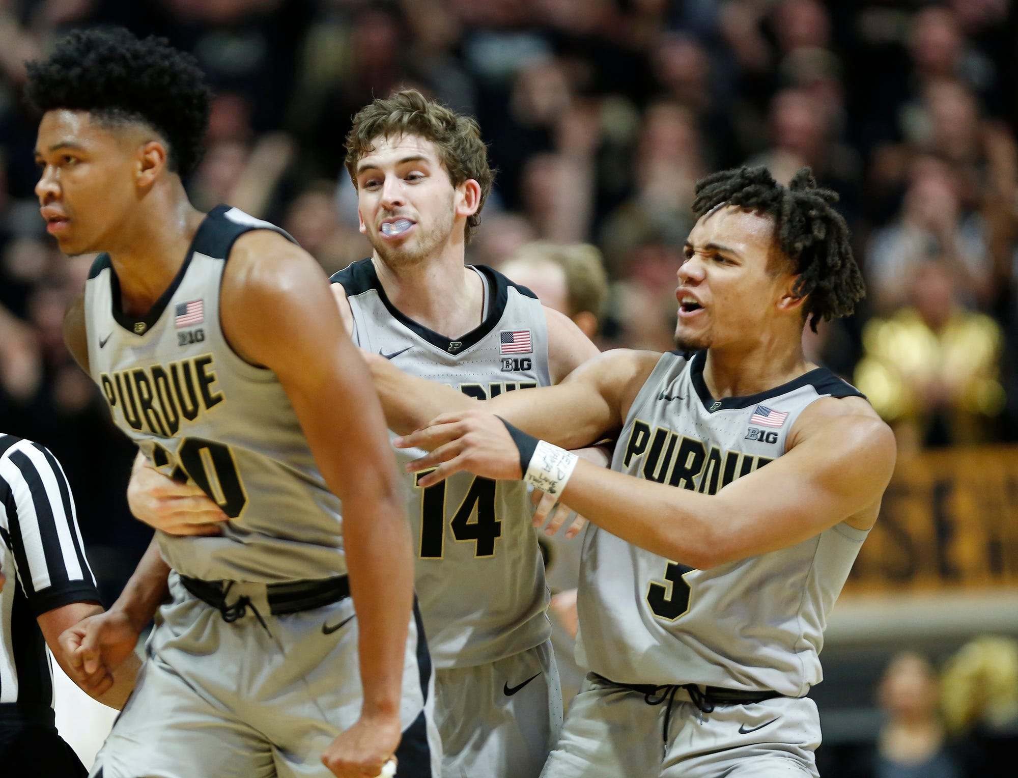 Carsen Edwards, from right, and Ryan Cline of Purdue clown with teammate Nojel Eastern after Eastern's basket put the Boilermakers up 69-52 over Ball State with 11:23 remaining Saturday, November 10, 2018, at Mackey Arena. Purdue defeated Ball State 84-75.