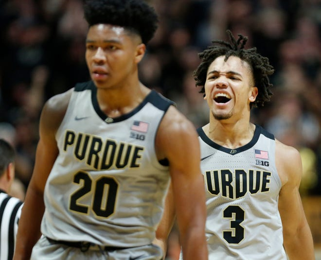 Carsen Edwards of Purdue screams at teammate Nojel Eastern after Eastern's basket put the Boilermakers up 69-52 over Ball State with 11:23 remaining Saturday, November 10, 2018, at Mackey Arena. Purdue defeated Ball State 84-75.