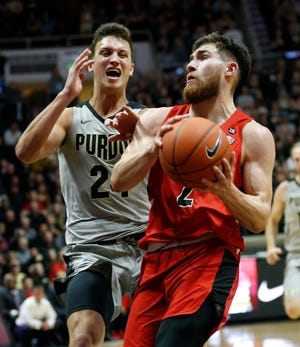 Tayler Persons of Ball State gets past Grady /Eifert of Purdue for a shot Saturday, November 10, 2018, at Mackey Arena.