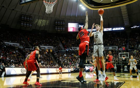 Matt Haarms of Purdue with a shot over Tahjai Teague of Ball State Saturday, November 10, 2018, at Mackey Arena. Purdue defeated Ball State 84-75.