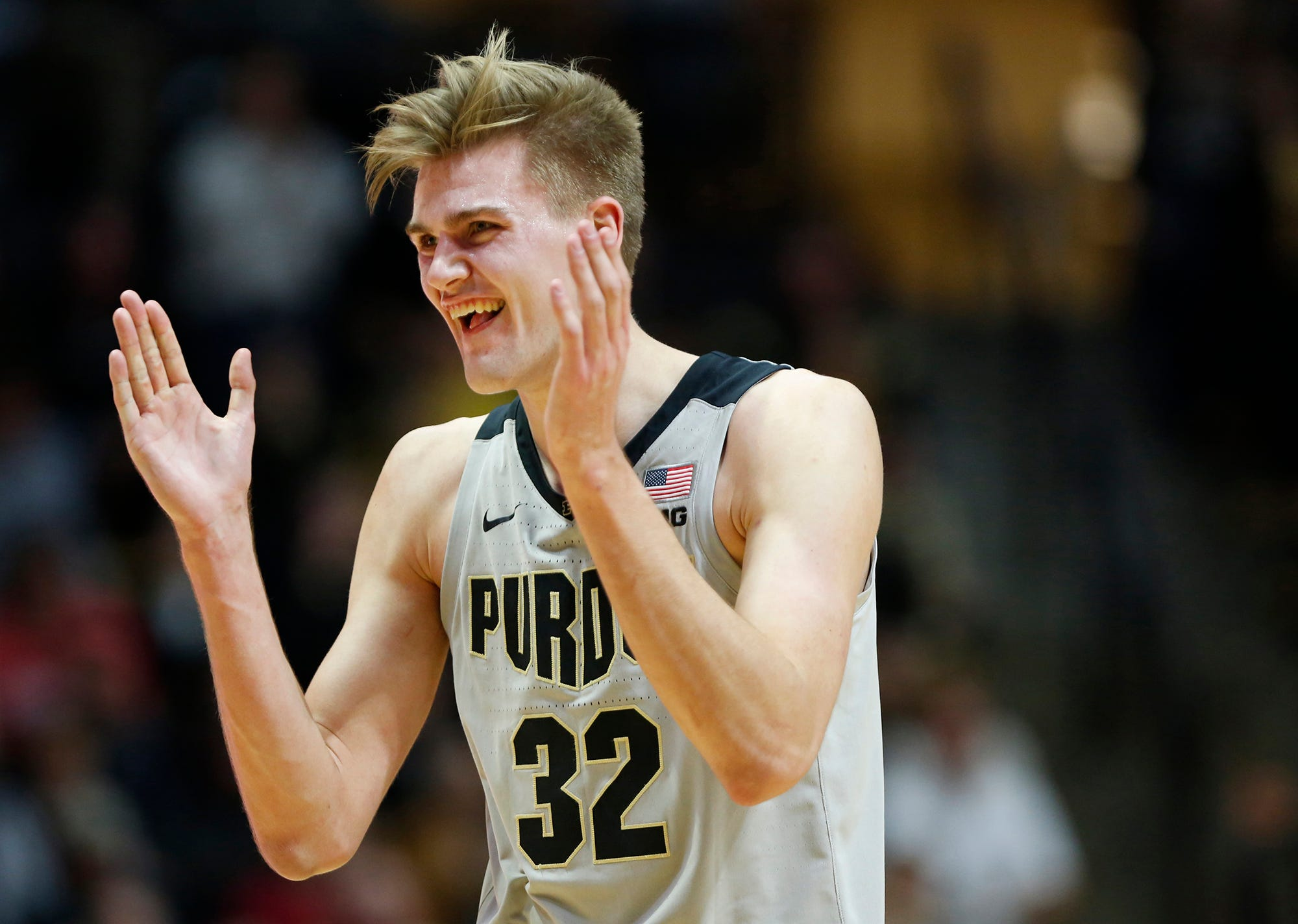 Matt Haarms of Purdue reacts as the Boilermakers go up 75-64 over Ball State with 6:58 remaining Saturday, November 10, 2018, at Mackey Arena. Purdue defeated Ball State 84-75.