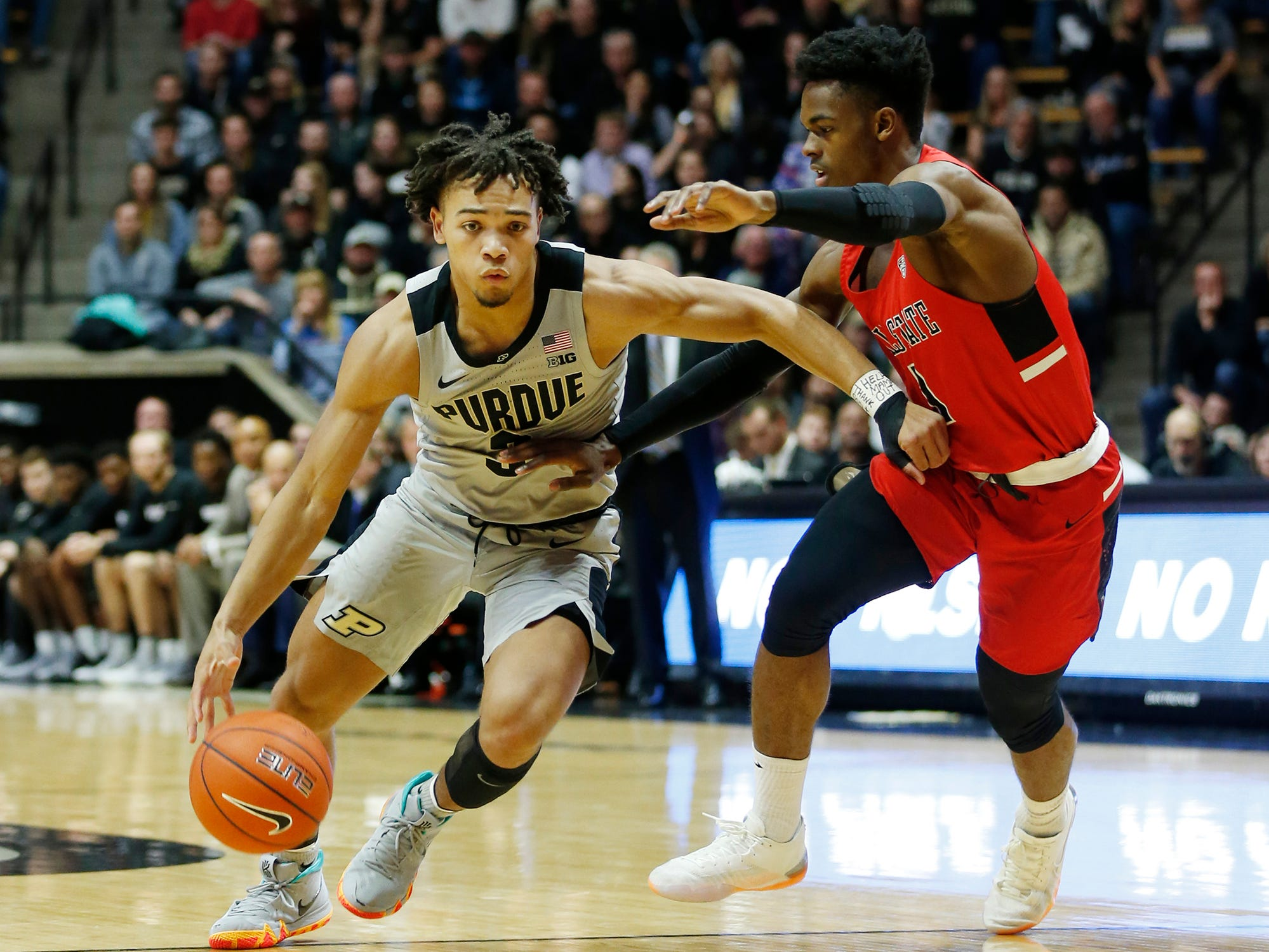 Carsen Edwards of Purdue works to get past K. J. Walton of Ball State Saturday, November 10, 2018, at Mackey Arena. Purdue defeated Ball State 84-75.