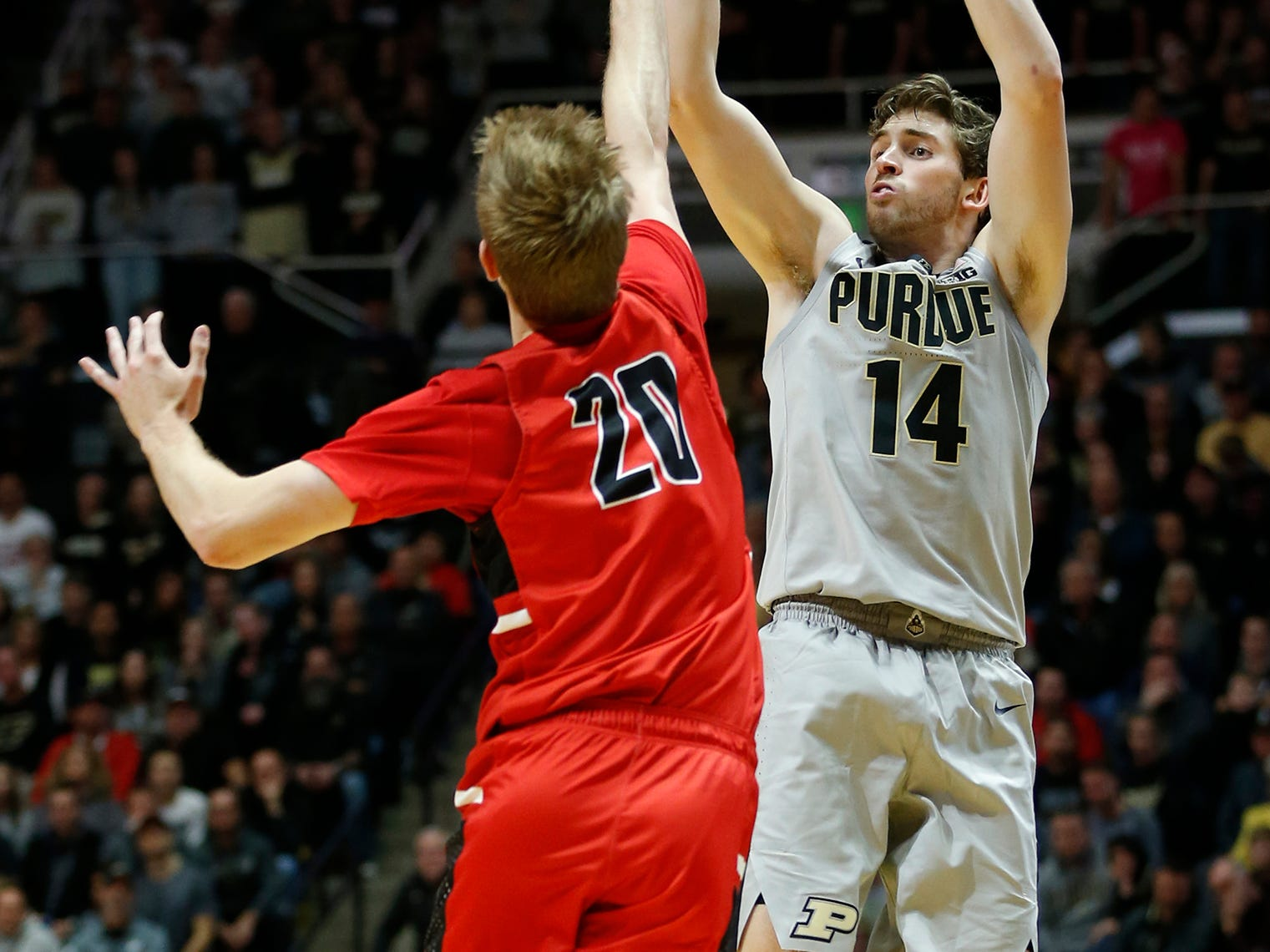 Ryan Cline of Purdue with a three-point shot over Austin Nehls of Ball State Saturday, November 10, 2018, at Mackey Arena. Purdue defeated Ball State 84-75.