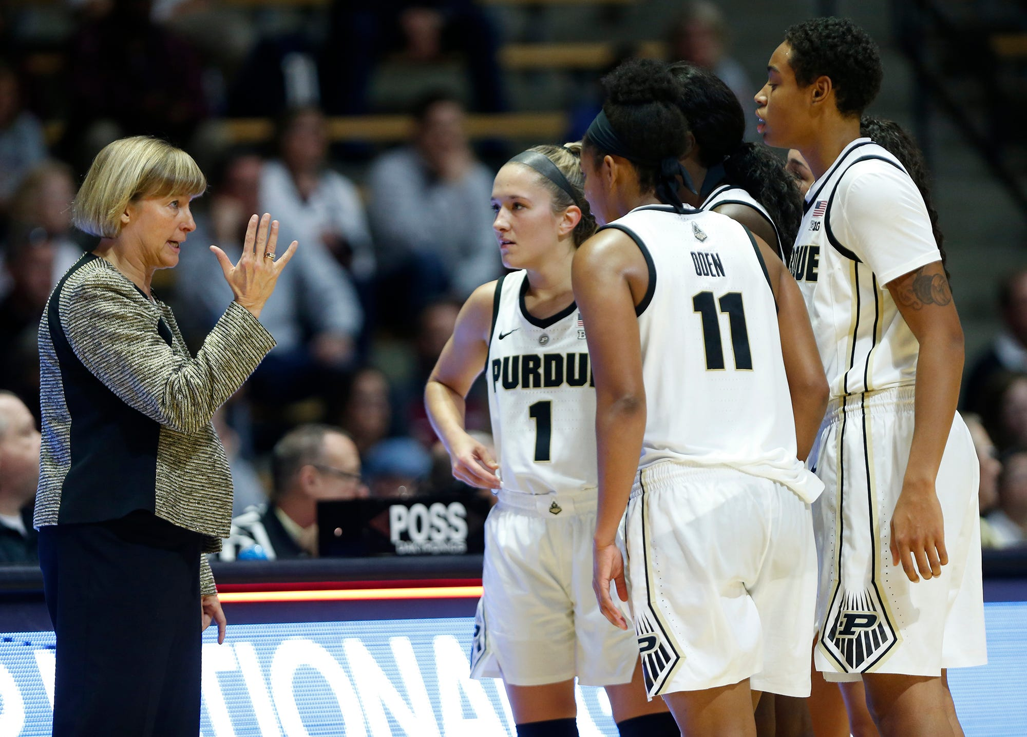 Purdue head coach Sharon Versyp gives directions to her players during a timeout against Harvard Sunday, November 11, 2018, at Mackey Arena. Purdue defeated Harvard 66-65.
