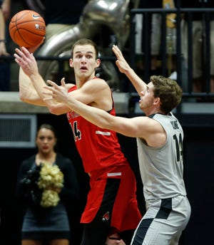 Kyle Mallers of Ball State with a pass over Ryan Cline of Purdue Saturday, November 10, 2018, at Mackey Arena. Purdue defeated Ball State 84-75.