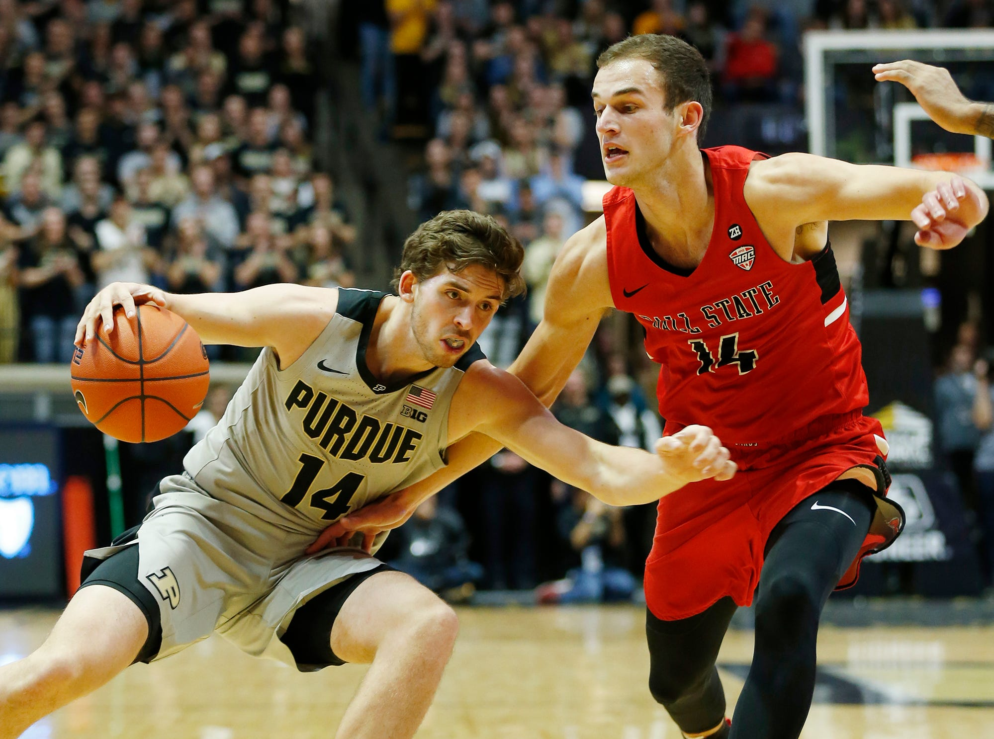 Ryan Cline of Purdue tries to slip beneath Kyle Mallers of Ball State Saturday, November 10, 2018, at Mackey Arena. Purdue defeated Ball State 84-75.