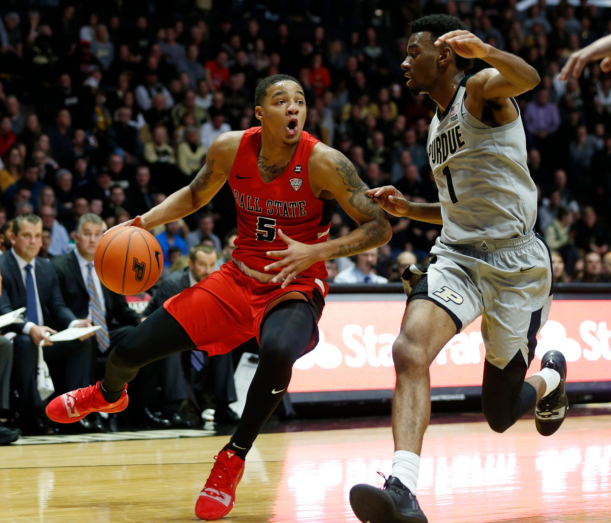Ishmael el-Amin of Ball State with a drive to the basket against Aaron Wheeler of Purdue Saturday, November 10, 2018, at Mackey Arena. Purdue defeated Ball State 84-75.