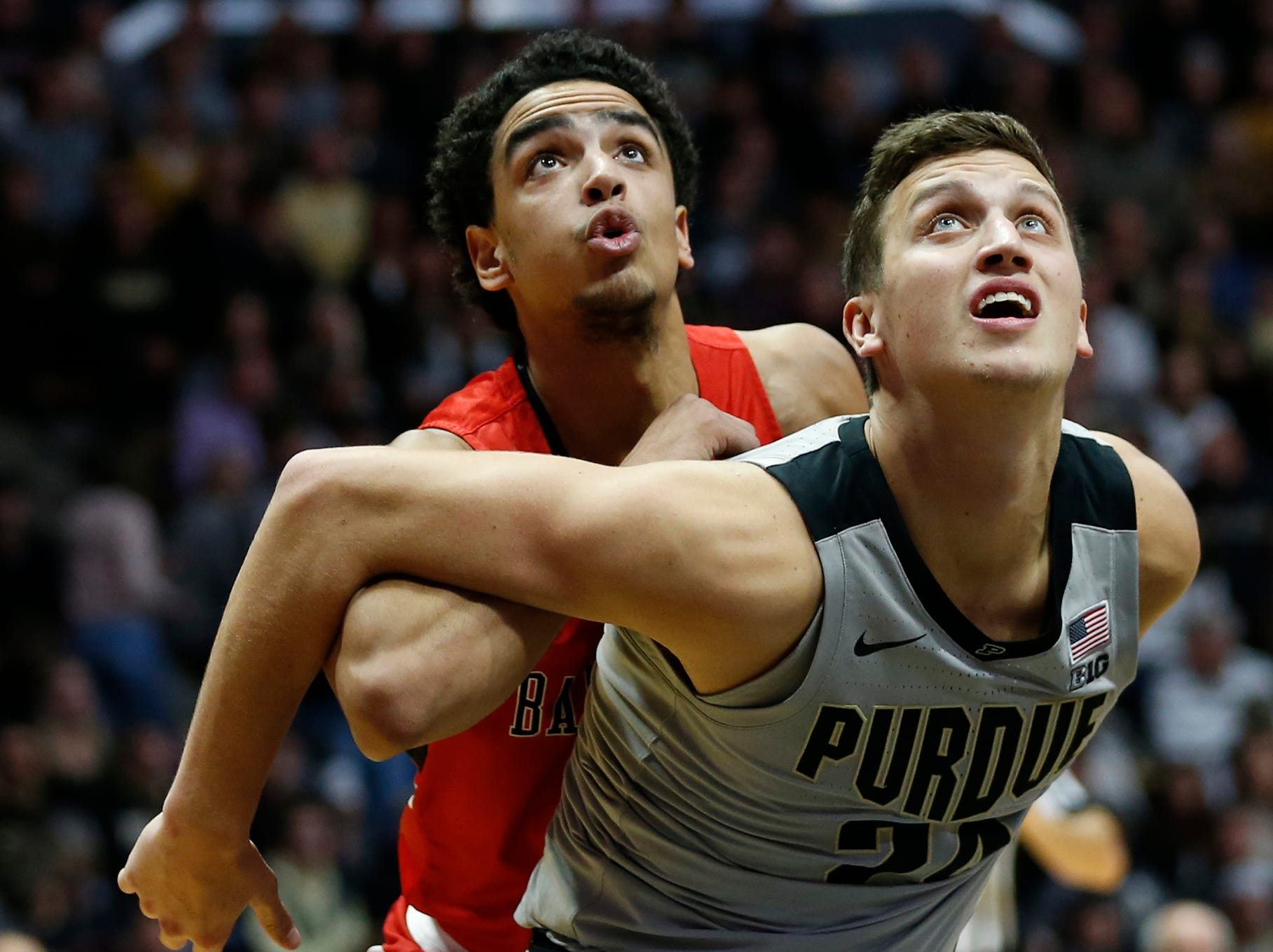 Grady Eifert of Purdue works to box out Zach Gunn of Ball State during a Boilermakers free throw attempt Saturday, November 10, 2018, at Mackey Arena. Purdue defeated Ball State 84-75.