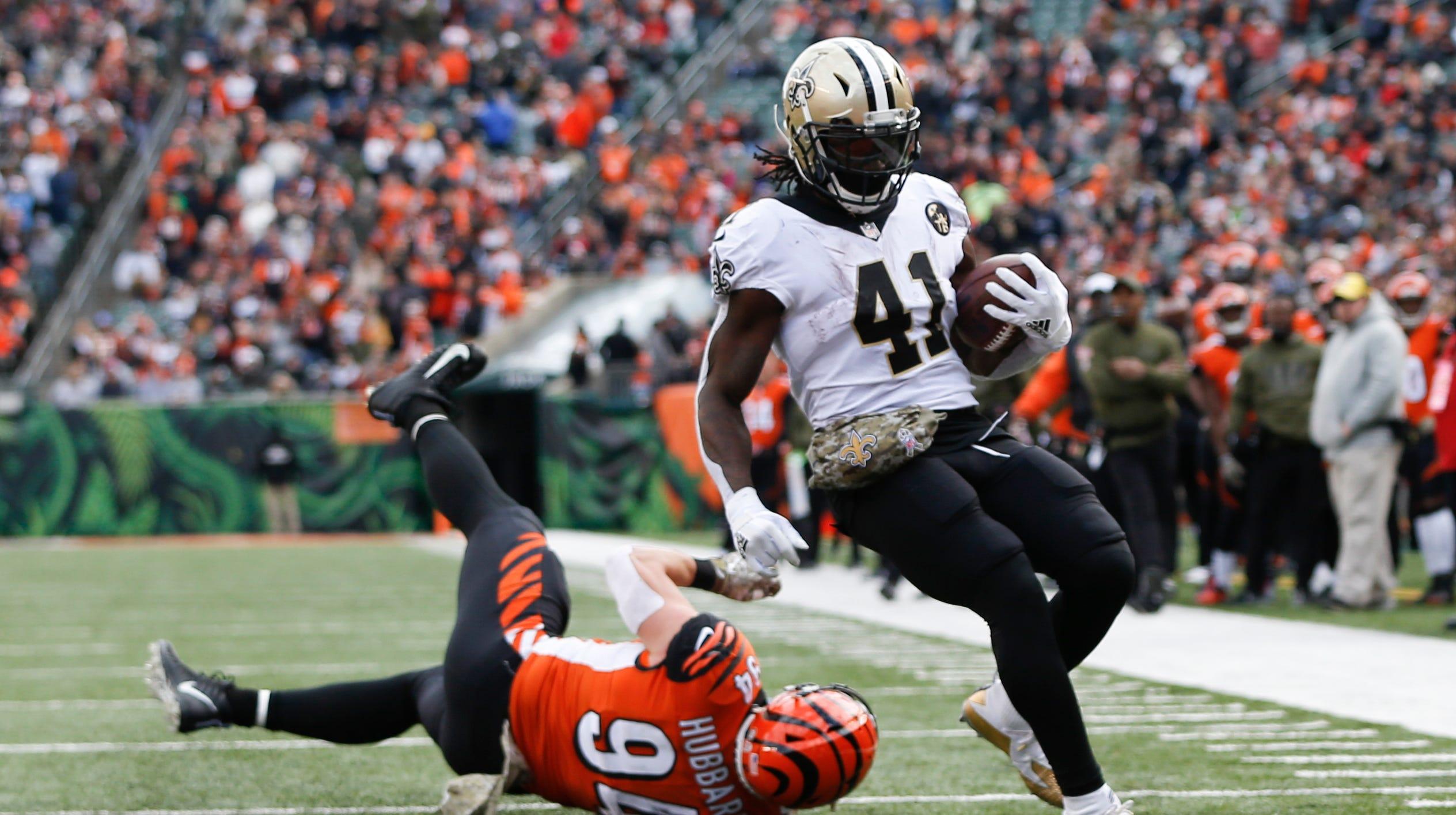 New Orleans Saints running back Alvin Kamara (41) runs in for a touchdown against Cincinnati Bengals defensive end Sam Hubbard (94) in the first half of an NFL football game, Sunday, Nov. 11, 2018, in Cincinnati.