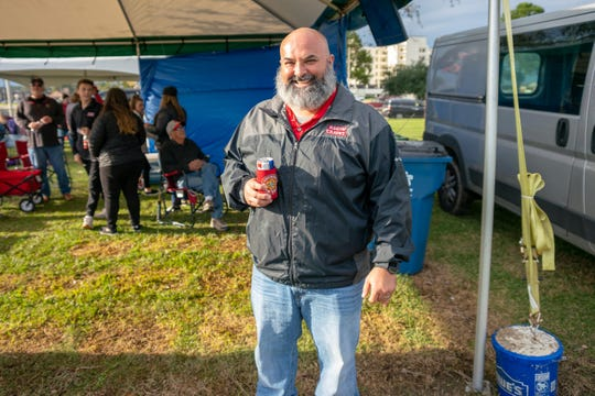 Ragin' Cajuns fan Cliff Burke tailgates under his tent at Cajun Field before Saturday's win over Georgia State.