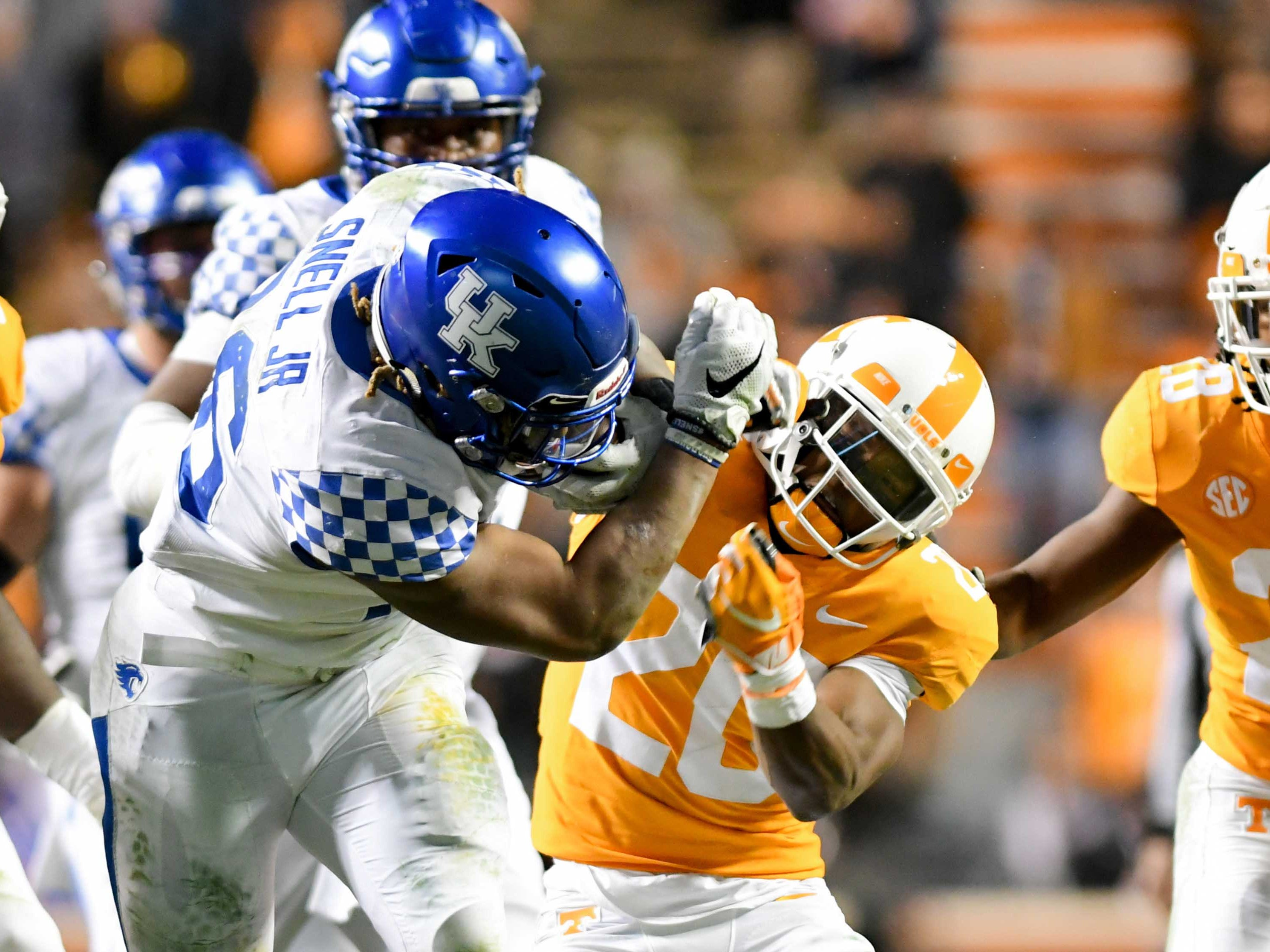 Kentucky Wildcats running back Benny Snell Jr. (26) runs the ball against Tennessee Volunteers defensive back Bryce Thompson (20) during the second half at Neyland Stadium in Knoxville, Tennessee, on Saturday, Nov. 10, 2018. Tennessee won 24-7.
