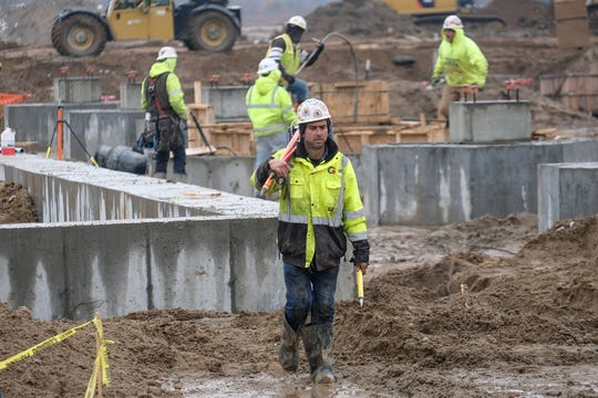Construction workers are on the site of the new $555 million cheese and dairy processing plant in St. Johns Friday, Nov. 9, 2018.
