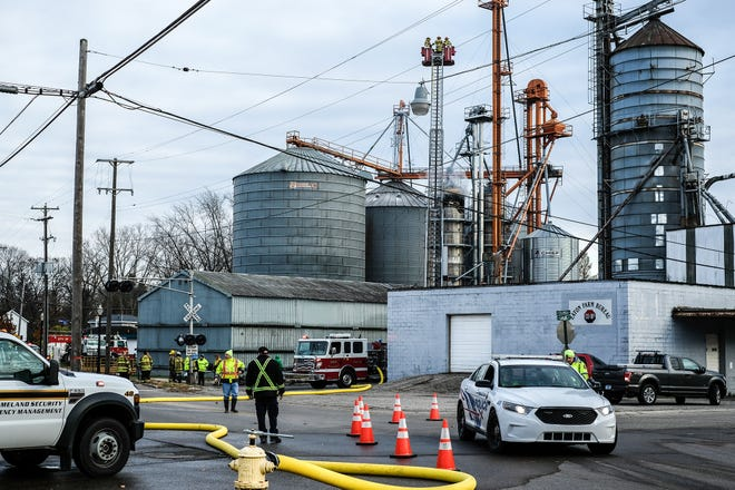 Fire and emergency crews from several municipalities respond to a silo fire in Mason Sunday, Nov. 11, 2018.