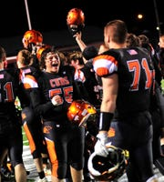 Lucas' football team members celebrate their win over Waterford at Coshocton on Saturday.
