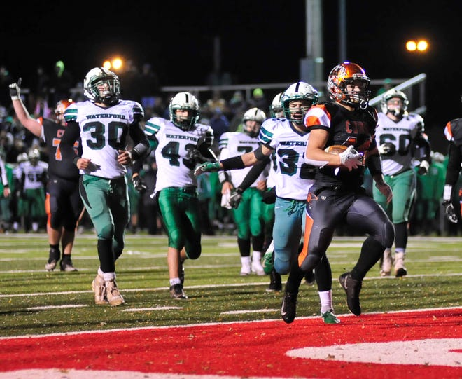 Jeb Grover scores one of his three touchdowns for Lucas in last week's 33-14 regional semifinal win over Waterford.