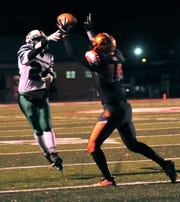 Tristen Arnold attempts to knock down a pass for Lucas in last week's 33-14 regional semifinal victory over Waterford.