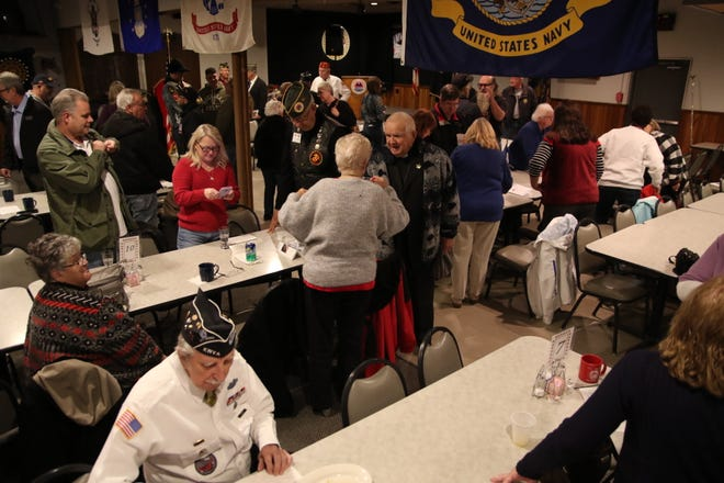 Dozens of veterans were honored during Sunday's Veterans Day ceremony at Amvets post 26 in Mansfield.