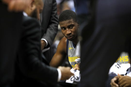 Grizzlies forward Jaren Jackson Jr. listens to coaches in the huddle during a timeout at FedExForum on Nov. 10.