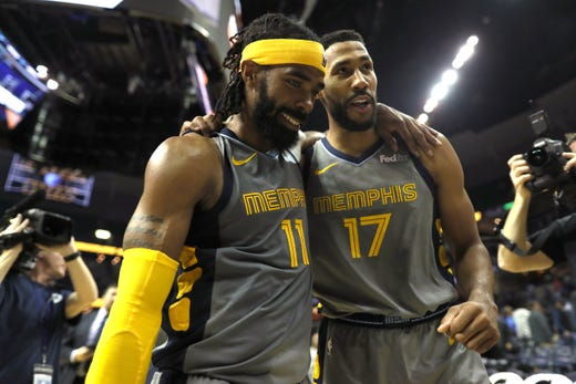 Memphis Grizzlies guard Mike Conley, left, and Garrett Temple walk off the court after beating the Philadelphia 76ers in overtime 112-106 at the FedExForum on Saturday, November 10, 2018.
