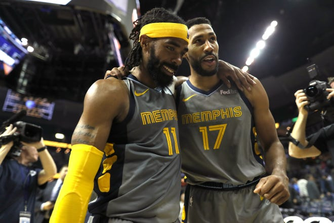 Grizzlies teammates Mike Conley, left, and Garrett Temple walk off the court after beating the Philadelphia 76ers in overtime on Nov. 10.