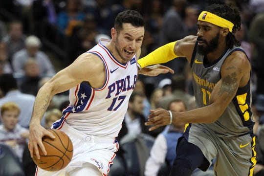 Grizzlies guard Mike Conley defends 76ers guard JJ Redick during their game Saturday at FedExForum.