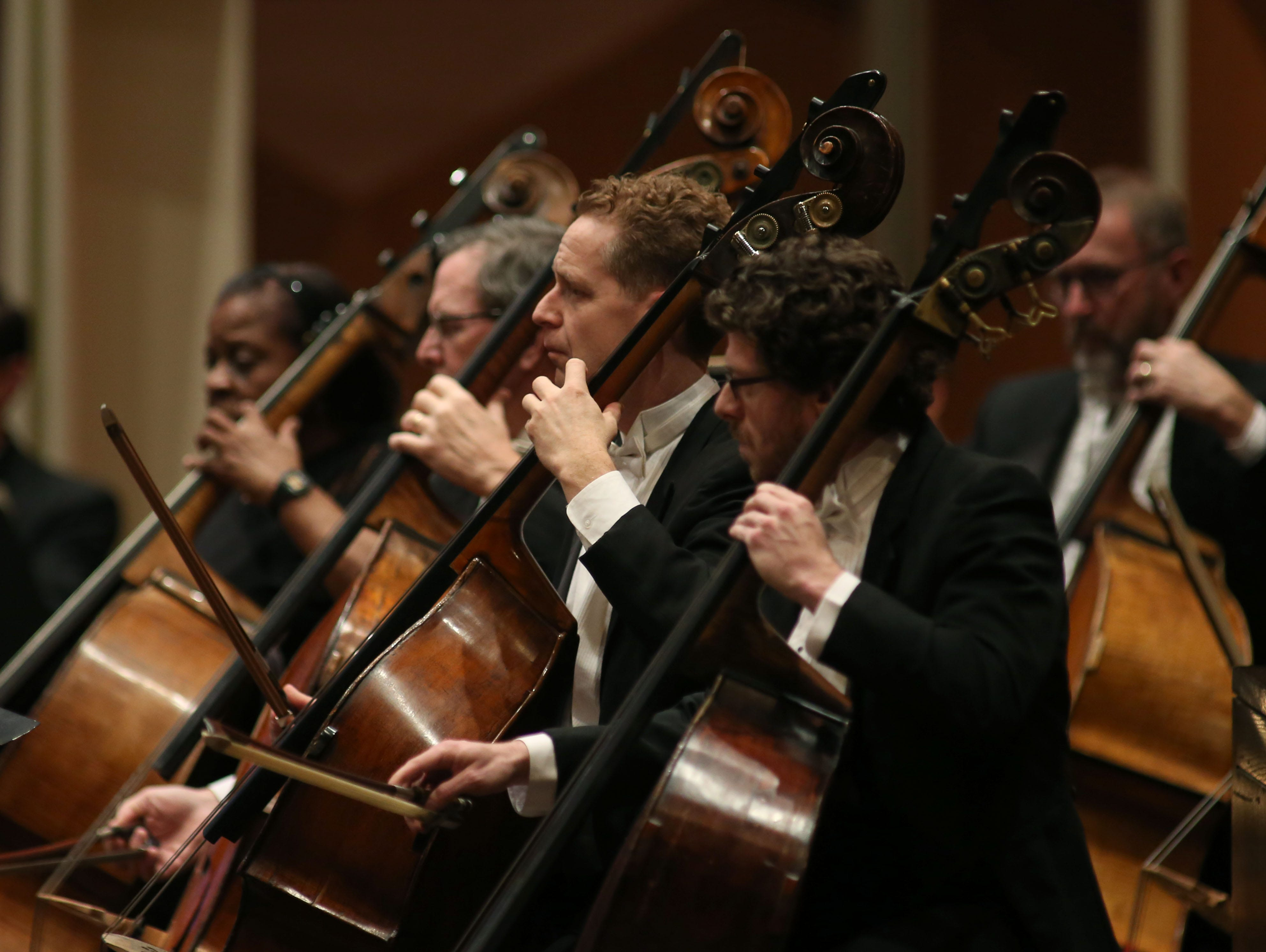 "The Milwaukee Symphony bass section plays during Wagner's Prelude to ""Die Meistersinger von Nurnberg"" Saturday night at the Marcus Center."